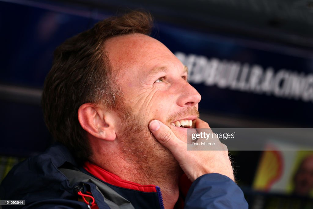Infiniti Red Bull Racing Team Principal Christian Horner smiles as Daniel Ricciardo of Australia and Infiniti Red Bull Racing celebrates on the podium in the pit lane after the Belgian Grand Prix at Circuit de Spa-Francorchamps on August 24, 2014 in Spa, Belgium.