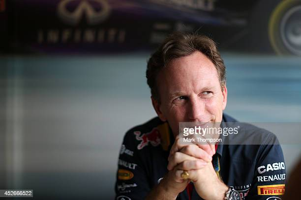 Infiniti Red Bull Racing Team Principal Christian Horner speaks with members of the media during practice ahead of the Hungarian Formula One Grand...