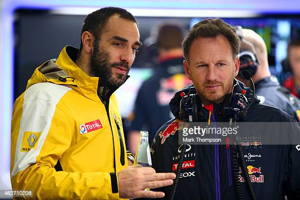 Infiniti Red Bull Racing Team Principal Christian Horner speaks with Renault's Cyril Abiteboul in the garage during day three of Formula One Winter...