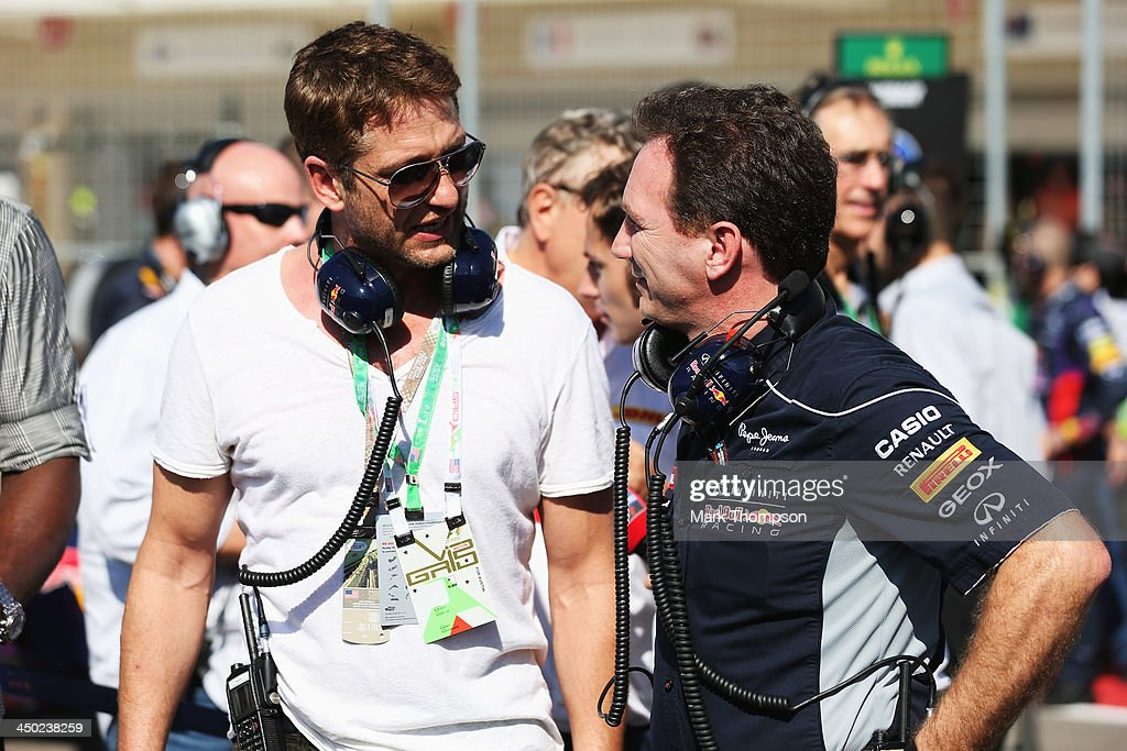 Infiniti Red Bull Racing Team Principal Christian Horner (R) talks with actor Gerard Butler on the grid before the United States Formula One Grand Prix at Circuit of The Americas on November 17, 2013 in Austin, United States.