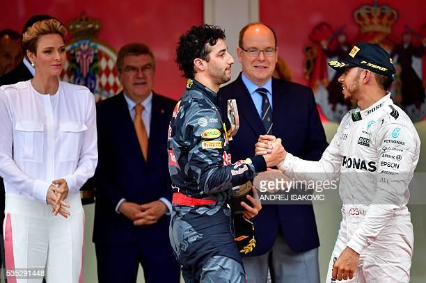 Infiniti Red Bull Racing's Australian driver Daniel Ricciardo congratulates Mercedes AMG Petronas F1 Team's British driver Lewis Hamilton in the...
