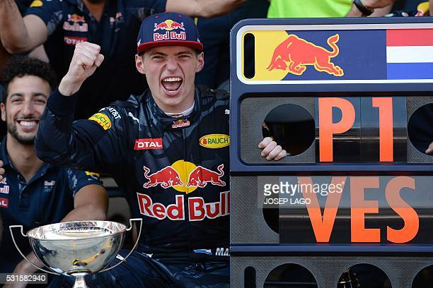 TOPSHOT Infiniti Red Bull Racing's Australian driver Daniel Ricciardo and Infiniti Red Bull's BelgianDutch driver Max Verstappen celebrate with their...