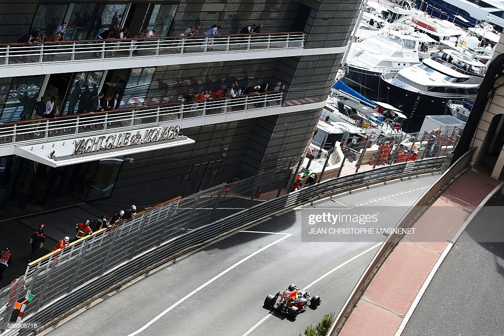 Infiniti Red Bull Racing's Australian driver Daniel Ricciardo drives at the Monaco street circuit, on May 29, 2016 in Monaco, during the Monaco Formula 1 Grand Prix. / AFP / JEAN
