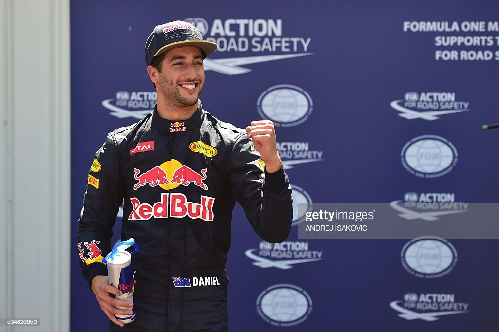 Infiniti Red Bull Racing's Australian driver Daniel Ricciardo celebrates in the parc ferme during the qualifying session at the at the Monaco street circuit, on May 28, 2016 in Monaco, one day ahead of the Monaco Formula 1 Grand Prix. / AFP / ANDREJ
