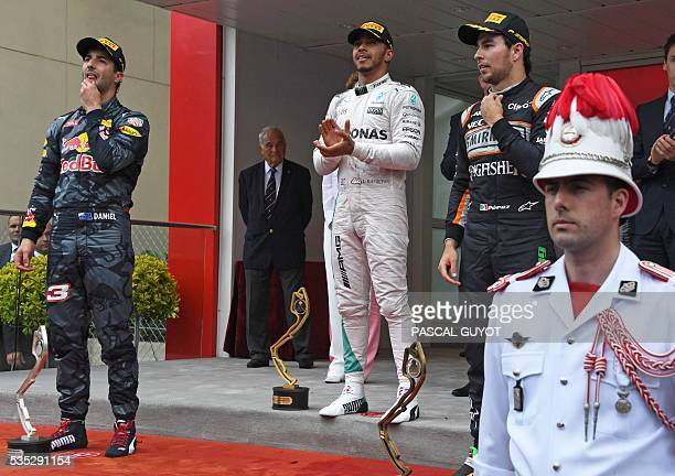 Infiniti Red Bull Racing's Australian driver Daniel Ricciardo Mercedes AMG Petronas F1 Team's British driver Lewis Hamilton and Sahara Force India F1...