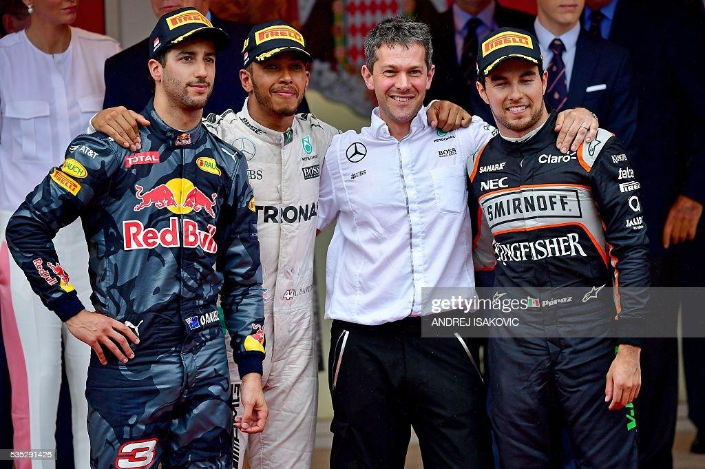 Infiniti Red Bull Racing's Australian driver Daniel Ricciardo, Mercedes AMG Petronas F1 Team's British driver Lewis Hamilton and Sahara Force India F1 Team's Mexican driver Sergio Perez celebrate on the podium at the Monaco street circuit, on May 29, 2016 in Monaco, after the Monaco Formula 1 Grand Prix. / AFP / ANDREJ