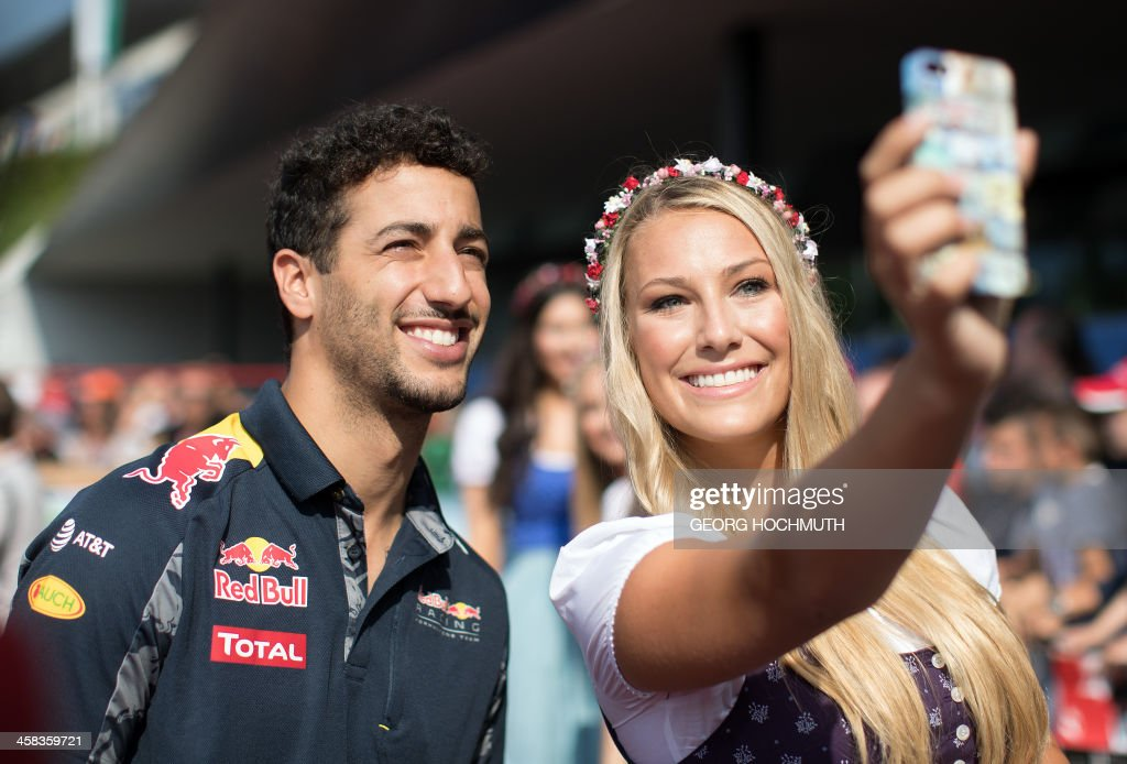 TOPSHOT - Infiniti Red Bull Racing's Australian driver Daniel Ricciardo poses for photos at the Red Carpet prior the third training session for the Formula One Grand Prix of Austria on July 2, 2016, in Spielberg ahead of the Formula One Grand Prix of Austria taking place on July 3, 2016. / AFP / APA / GEORG HOCHMUTH / Austria OUT