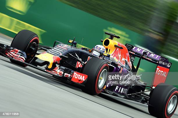 Infiniti Red Bull Racing's Australian driver Daniel Ricciardo races at the Circuit Gilles Villeneuve in Montreal on June 5 during the first practice...