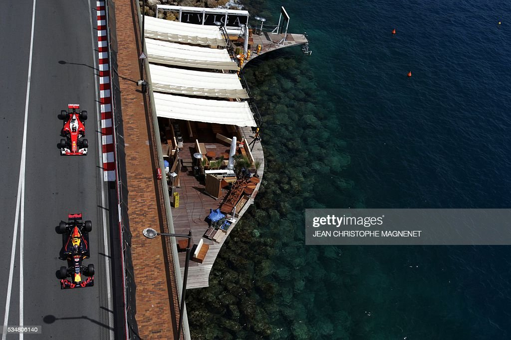 Infiniti Red Bull racing's Belgian-Dutch driver Max Verstappen and Ferrari's German driver Sebastian Vettel drive during the third practice session at the Monaco street circuit, on May 28, 2016 in Monaco, one day ahead of the Monaco Formula 1 Grand Prix. / AFP / JEAN