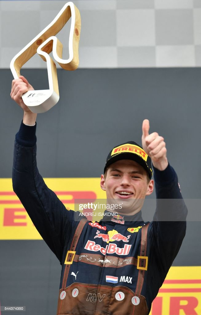 Infiniti Red Bull racing's BelgianDutch driver Max Verstappen celebrates on the podium after the Formula One Grand Prix of Austria at the Red Bull...