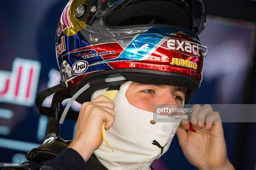 Infiniti Red Bull racing's Belgian-Dutch driver Max Verstappen puts his helmet on during the first practice session at the Monaco street circuit, on May 26, 2016 in Monaco, three days ahead of the Monaco Formula 1 Grand Prix. / AFP / ANDREJ