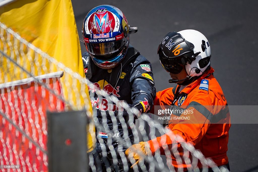 Infiniti Red Bull Racing's Belgian-Dutch driver Max Verstappen steps out of his car after a crash during the qualifying session at the at the Monaco street circuit, on May 28, 2016 in Monaco, one day ahead of the Monaco Formula 1 Grand Prix. / AFP / POOL / ANDREJ