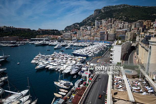 Infiniti Red Bull racing's driver drives during the third practice session at the Monaco street circuit on May 28 2016 in Monaco one day ahead of the...