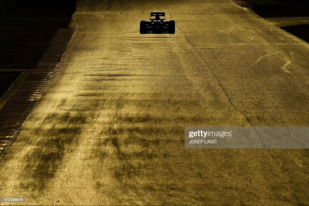 TOPSHOT - Infiniti Red Bull Racing's Russian driver Daniil Kvyat drives at the Circuit de Catalunya on February 25, 2016 in Montmelo on the outskirts of Barcelona on the fourth test day of the Formula One Grand Prix season. / AFP / JOSEP