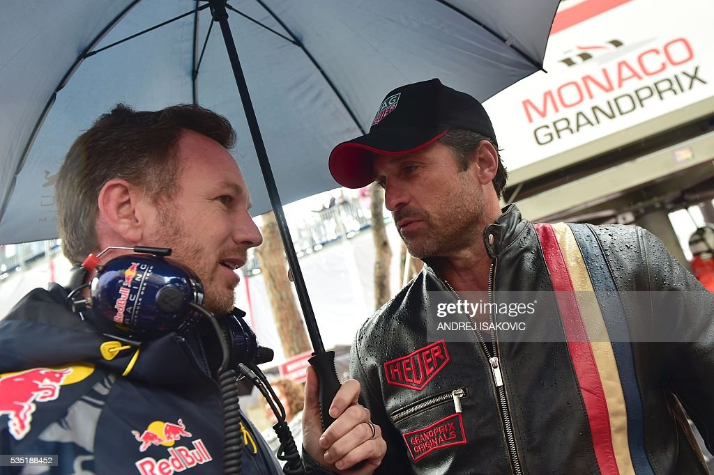 Infiniti Red Bull Racing's team principal Christian Horner (L) speaks with US actor Patrick Dempsey (R) at the Monaco street circuit, on May 29, 2016 in Monaco, ahead of the Monaco Formula 1 Grand Prix. / AFP / ANDREJ