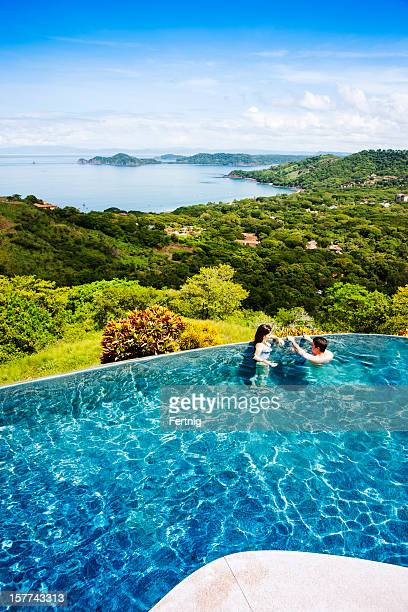 Infinity pool with a view. Couple on vacation