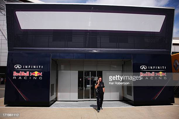 Infinti Red Bull Racing Team Principal Christian Horner talks on his phone in the paddock before the British Formula One Grand Prix at Silverstone...