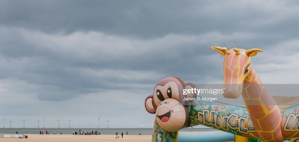 Inflatable animals at a childrens playground on August 12, 2017 in Great Yarmouth, England. A cloudy overcast day greeted visitors to the Norfolk seaside town on one of the busiest weekends of the summer period. The town has been a seasiside resort since 1760 and today it has developed renewable energy sources with a wind farm of 30 generators within sight of the town in the North Sea. Thousands of British holidaymakers will visit the area over the summer period.