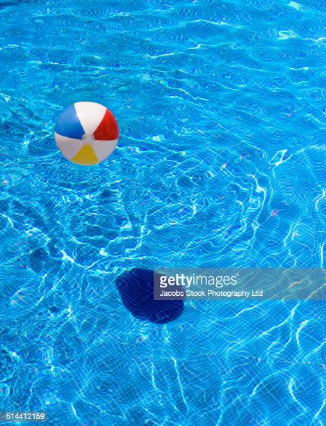 Inflatable ball casting shadow in swimming pool