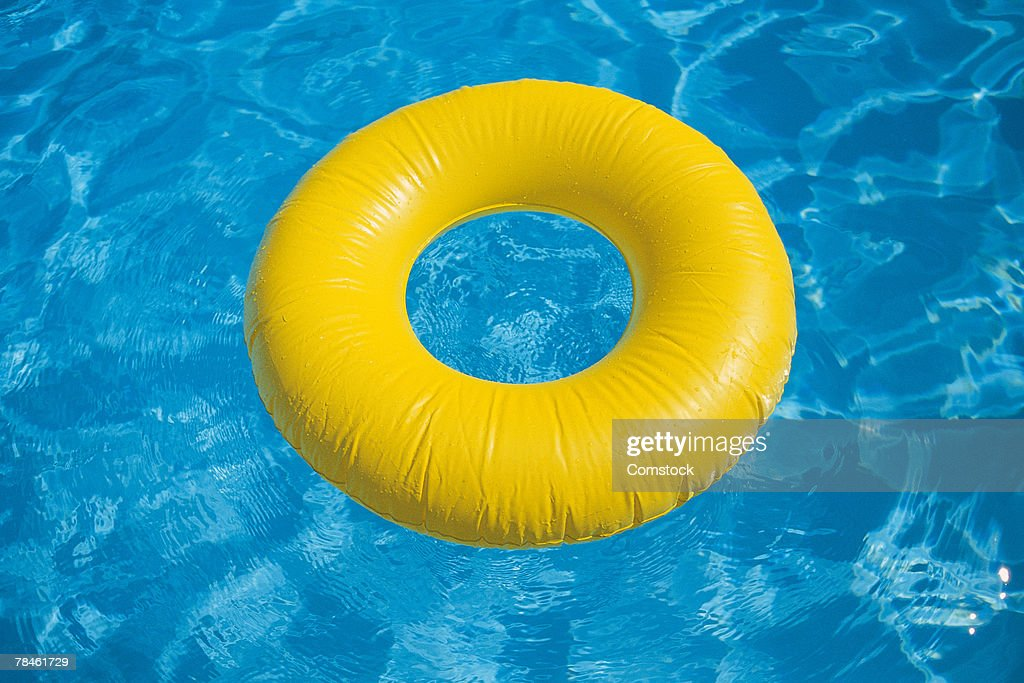 Inflatable flotation ring in swimming pool