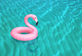 Inflatable pink flamingo floating on the sea surface. 3D rendering