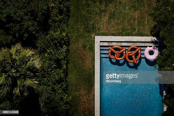 Inflatable pretzel and donut rafts are seen floating in a swimming pool on the backyard of a home off Summit Drive in this aerial photograph taken...