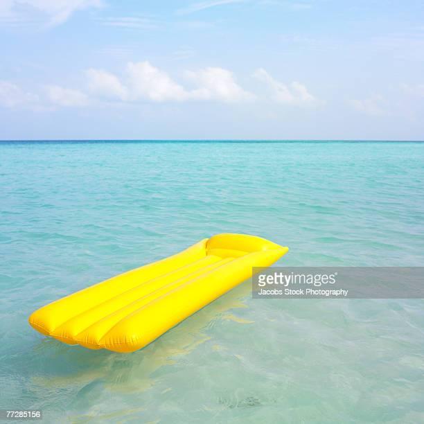 Inflatable raft floating in ocean