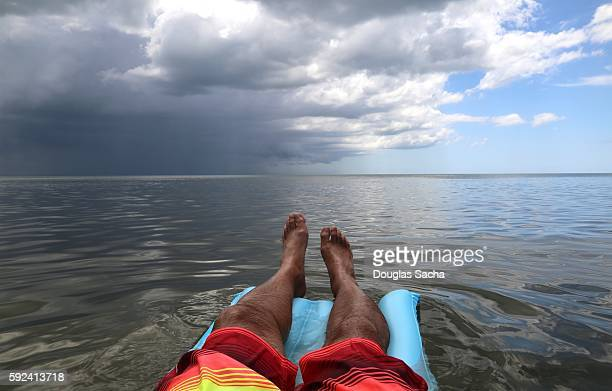 Inflatable raft in the open water with a approching storm