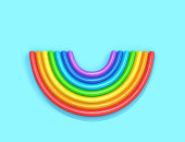 Inflatable rainbow isolated on blue background, top view. 3D rendering with clipping path
