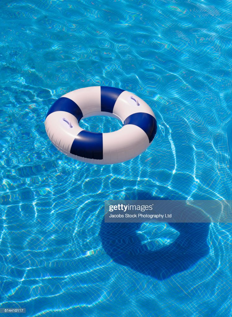 Inflatable ring casting shadow in swimming pool