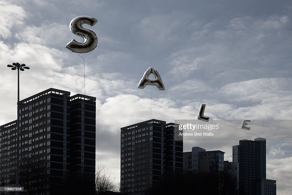 inflatable sale signs over high rise apartments : Stock Photo