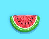 Inflatable watermelon slice isolated on blue background,  top view. 3D rendering with clipping path