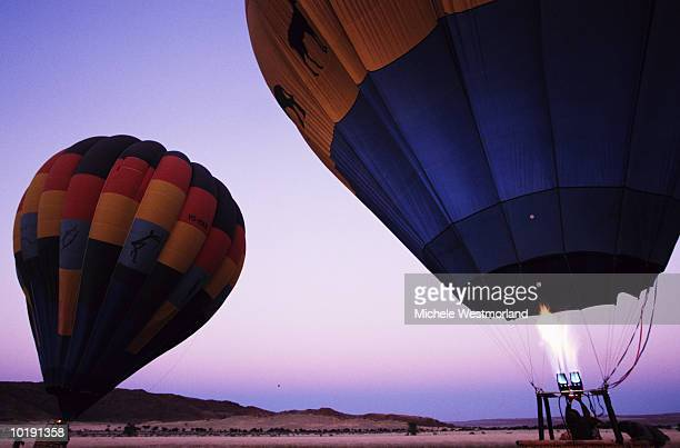Inflating hot air balloons for desert trip, Namibia