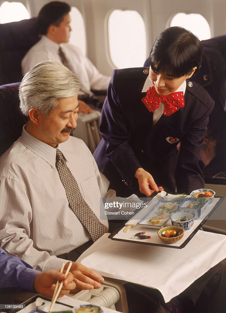In-flight meal service in first class : Stock Photo