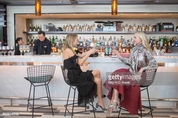 S influencers Blair Eadie and Leonie Hanne at the opening of the American Express Centurion Lounge at Hong Kong international airport on September 29...
