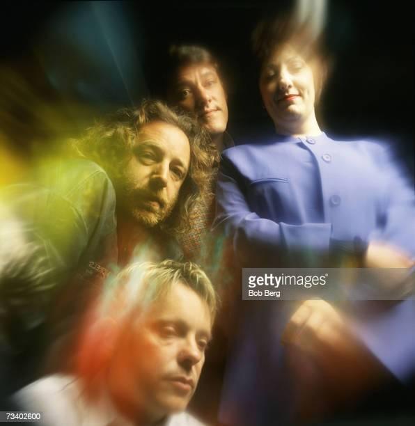 Influential British rockers New Order bassist Peter Hook drummer Stephen Morris lead vocalist/guitarist Bernard Sumner and keyboardist Gillian...
