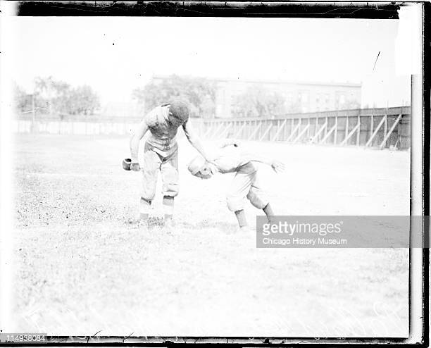 Informal fulllength portrait of African American football player Bro Pallard of Lane High School leaning forward standing with an unidentified...