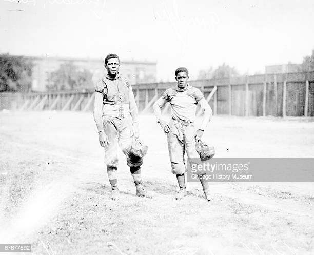 Informal fulllength portrait of African American football player Bro Pallard and an unidentified African American football player both of Lane High...