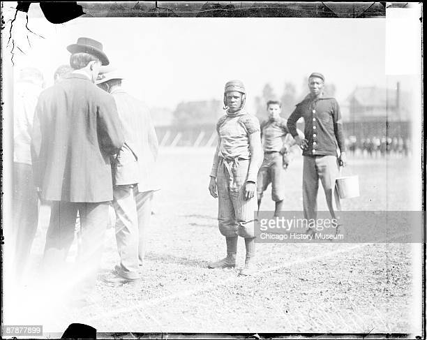 Informal fulllength portrait of African American football player Bro Pallard of Lane High School standing on an athletic field in Chicago Illinois...