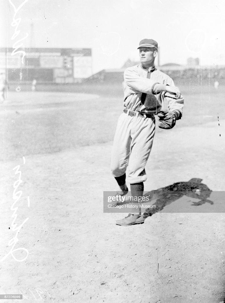 Informal fulllength portrait of baseball player Walter Johnson of the American League's Washington Senators following through after throwing a...