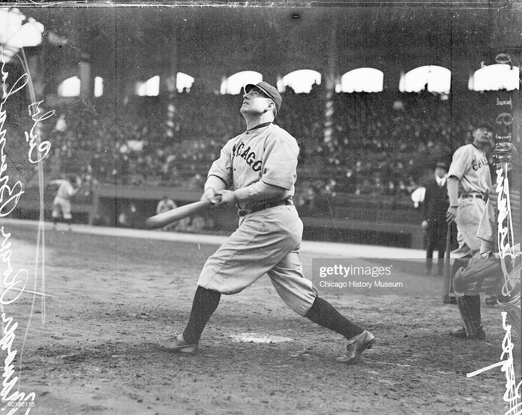 Informal fulllength portrait of Hall of Fame baseball player and manager Roger Bresnahan of the National League's Chicago Cubs following through and...