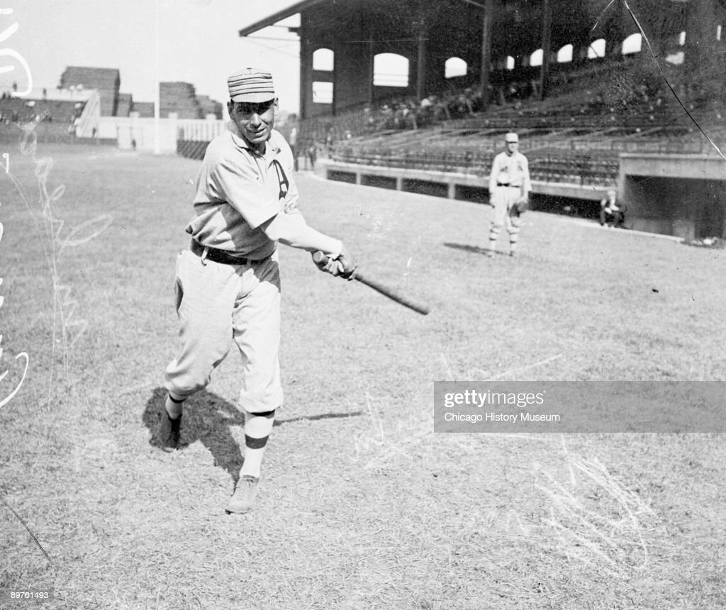 Informal fulllength portrait of Hall of Fame baseball player Charles 'Chief' Bender of the American League's Philadelphia Athletics following through...
