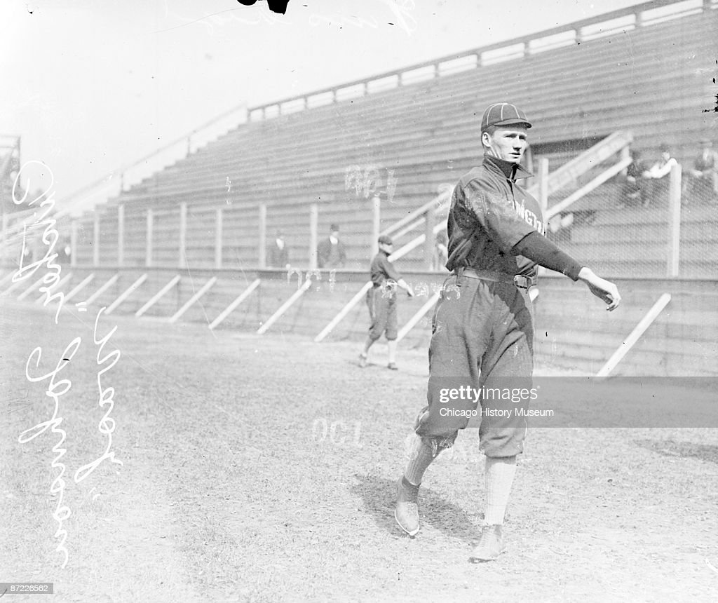 Informal fulllength portrait of the great Walter Johnson pitcher for the American League's Washington baseball team following through after throwing...