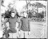 Informal fulllength portrait of University High School football players Usher and Wagner standing on a grass field in Chicago Illinois 1909 A...
