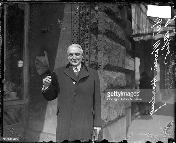 Informal portrait of Senator Warren G Harding the 1920s Republican candidate for President standing in front of the Auditorium Theater in the Loop...