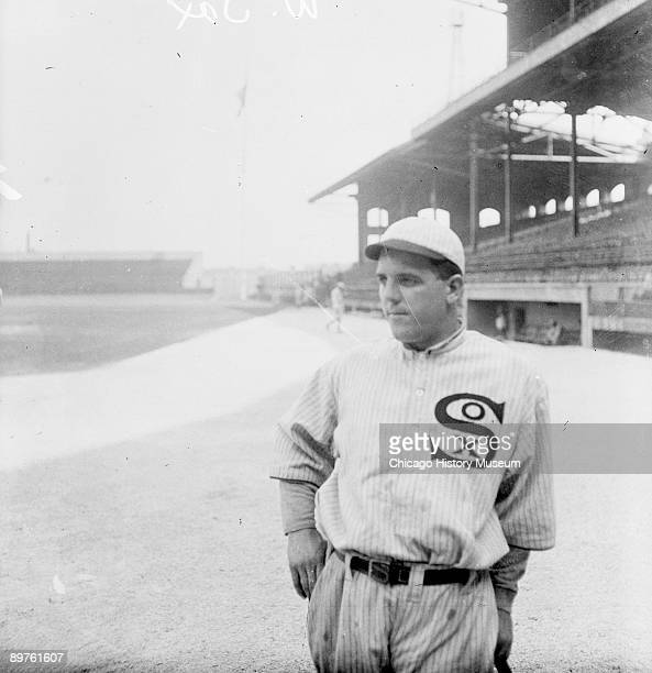 Informal threequarter length portrait of baseball player Eddie Cicotte of the American League's Chicago White Sox leaning on a baseball bat standing...