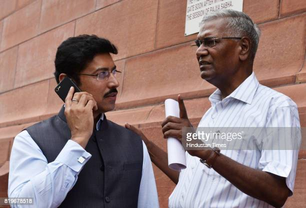 Information and Broadcasting Minister Col Rajyavardhan Rathore and CPI leader D Raja at Parliament house during the Monsoon Session on July 20 2017...