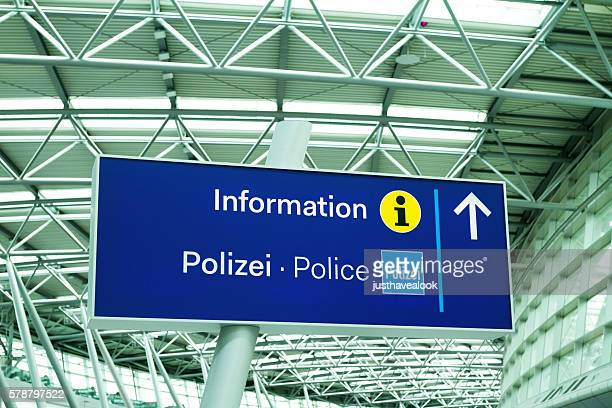 Information and police sign in airport Düsseldorf