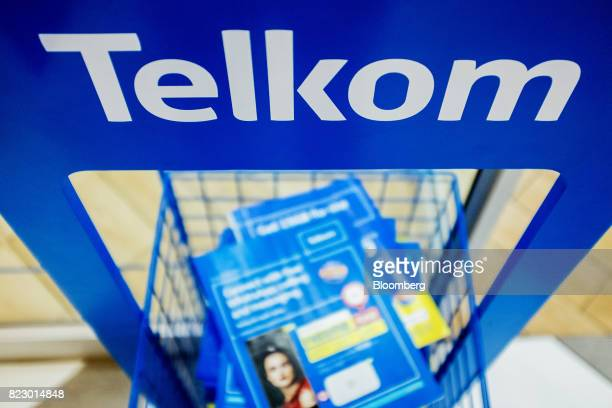 Information brochures sit on display inside a phone store operated by Telkom SA SOC Ltd at the Menlyn Park shopping center in Pretoria South Africa...