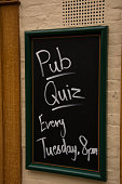 hand written Pub quiz sign using liquid chalk